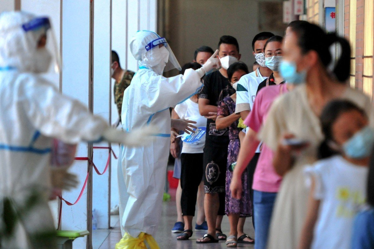 Residents queue to undergo nucleic acid tests for the Covid-19 coronavirus in China which is fighting new outbreaks of the coronavirus. Photo: AFP