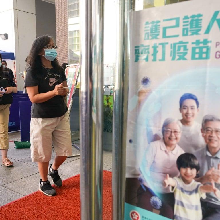People queue to get their Covid-19 jabs at Sun Yat Sen Memorial Park Sports Centre. Photo: Felix Wong
