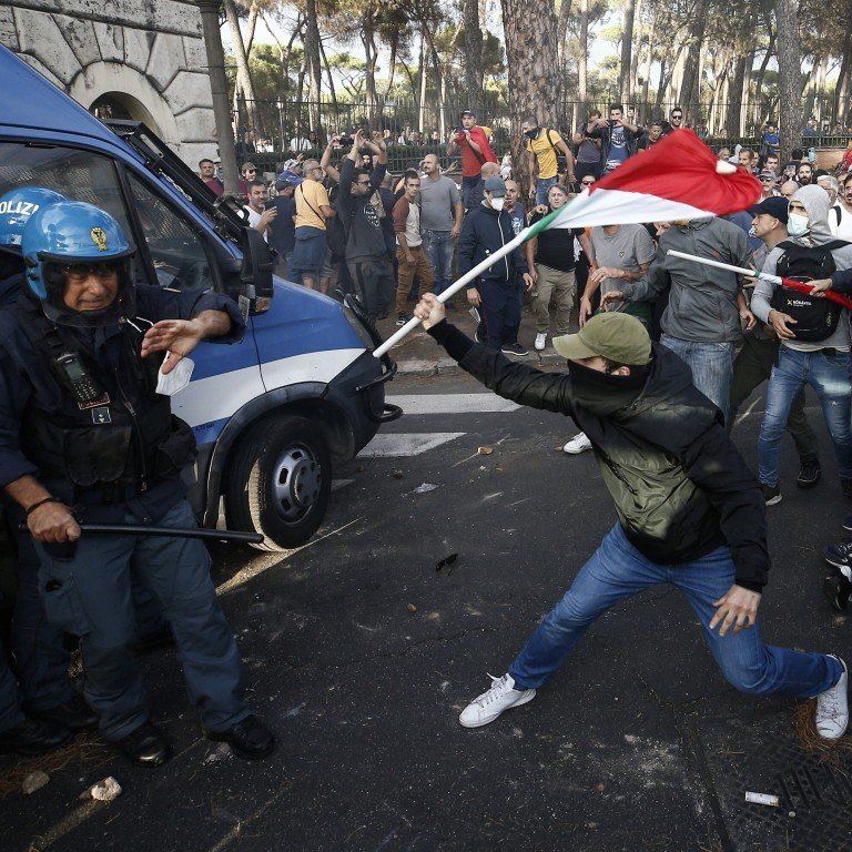 Police clash with demonstrators during a protest against the Covid-19 health pass in Rome, Italy on Saturday. Photo: LaPresse via AP