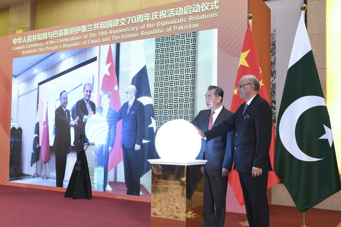 Foreign Minister Wang Yi (second right) attends a virtual ceremony with Pakistani Foreign Minister Shah Mahmood Qureshi to formally commence the celebrations of the 70th anniversary of diplomatic relations between the two countries in Beijing on March 2. Photo: Xinhua