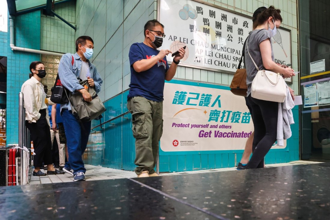 People line up to receive the BioNTech jab at the community vaccination centre at Ap Lei Chau Sports Centre. Photo: K. Y. Cheng