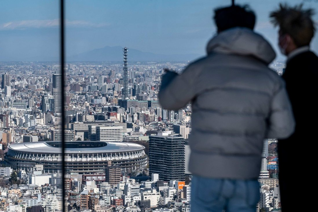 Visitors to the Shibuya Sky observation deck in Tokyo enjoy the view. Photo: AFP