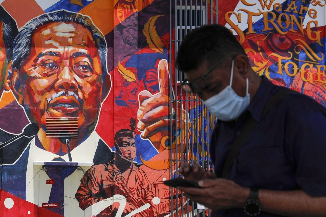 A mural depicting Malaysian Prime Minister Muhyiddin Yassin at government clinic in Kuala Lumpur. Photo: EPA