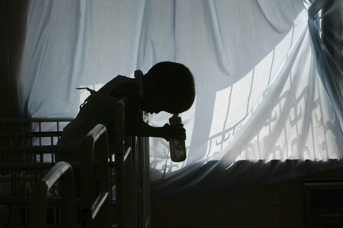 A five-year-old disabled victim of Agent Orange rests on his cot in a Ho Chi Minh City hospital in 2005. Photo: Reuters