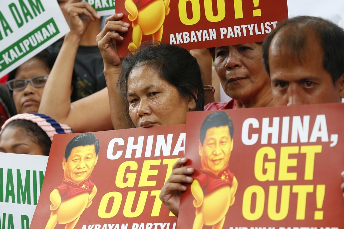 Demonstrators rally outside the Chinese consulate on November 21, 2018. Photo: AP