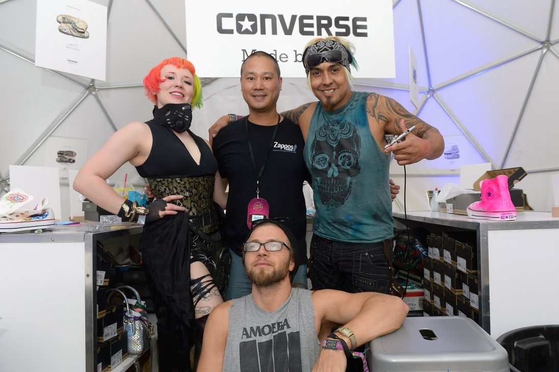 Tony Hsieh (back, centre) with artists Heather Hermann (left), Gear Duran (right) and Brett Bandriwski at the 2015 Life is Beautiful festival in Las Vegas, Nevada. Photo: WireImage/Getty Images
