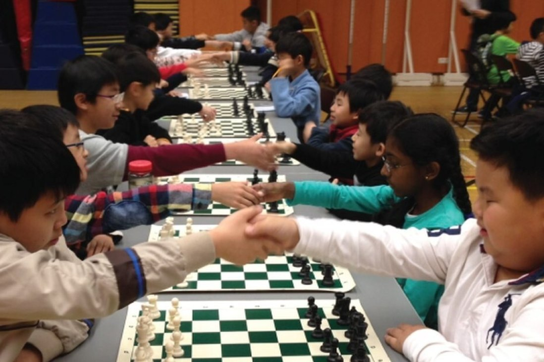 Young players shake hands before the start of a chess tournament in Hong Kong. Photos: ActiveKids