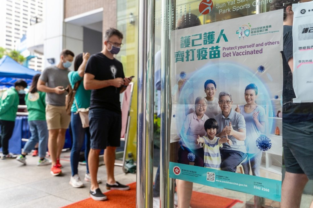 A poster advertising the vaccination programme outside a community vaccination centre in Hong Kong on April 26. Photo: Bloomberg