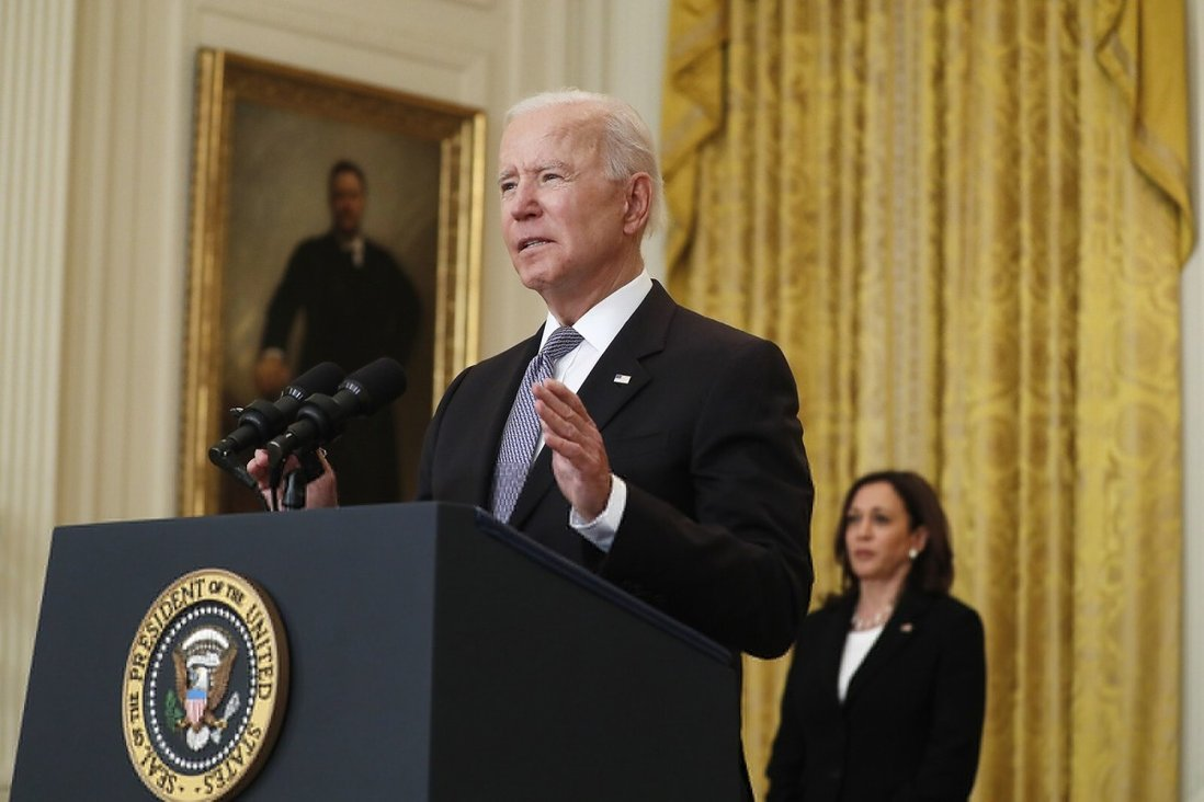 US President Joe Biden, with Vice-President Kamala Harris in the background, announces the US will donate 80 million vaccine doses to the rest of the world. Photo: TNS