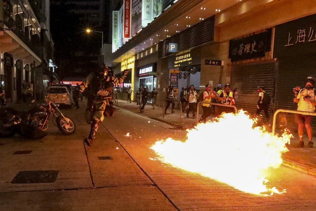 Protesters hurl petrol bombs at riot police in Wan Chai in 2019. Photo: Felix Wong