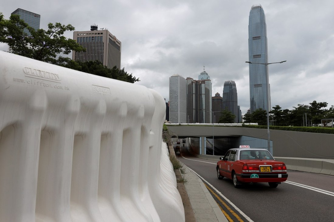 Water-filled barriers are seen in the Hong Kong central business district. A report warned years of border closures would drive economies toward self-sufficiency and could have negative effects. Photo: Reuters