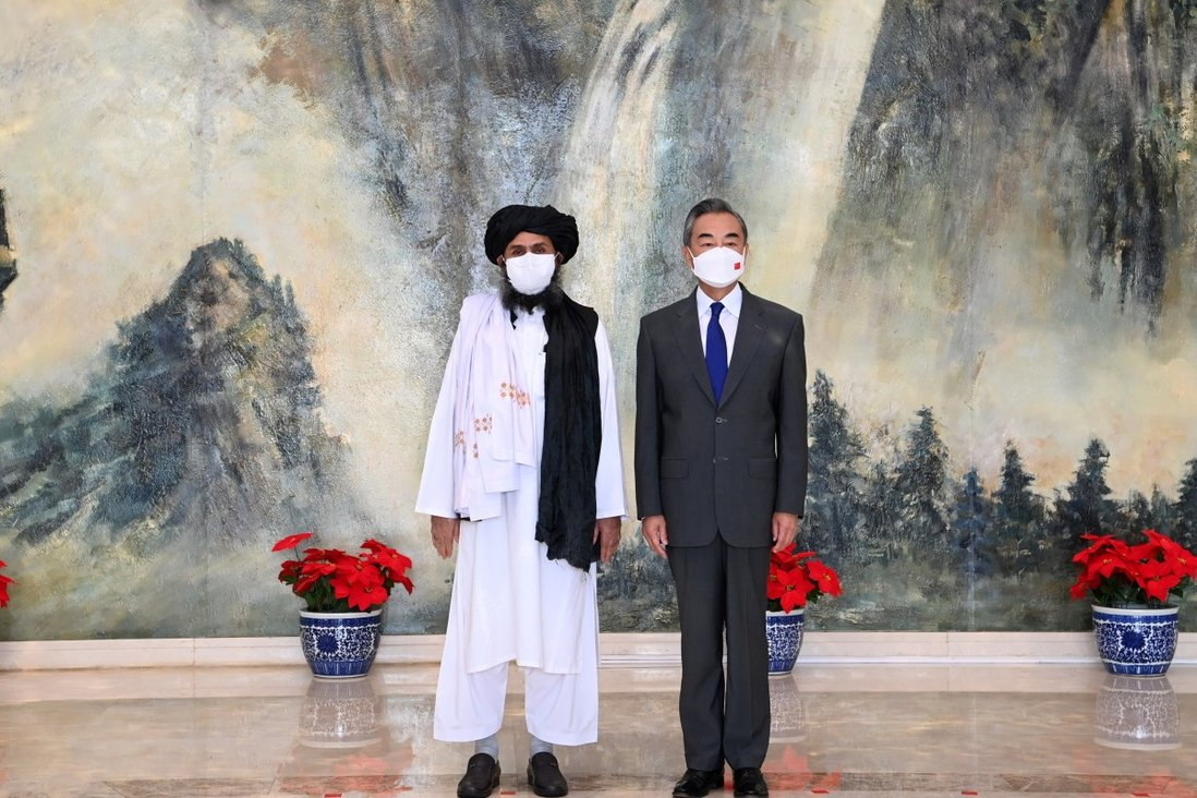 Chinese State Councillor and Foreign Minister Wang Yi with Mullah Abdul Ghani Baradar, political chief of Afghanistan's Taliban, in Tianjin, China, in July. Photo: Xinhua