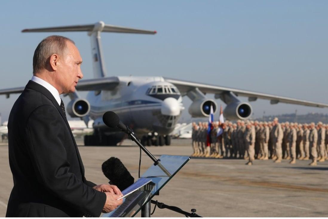 Russian President Vladimir Putin (left) visits the Khmeimim Air Base in Syria on December 11. Photo: EPA