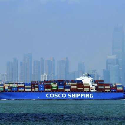A China Cosco Shipping container ship sails past the skyline of Qingdao in eastern Shandong province on July 28. China's transformation into an economic power is premised on its integration into global trade networks. Photo: AP