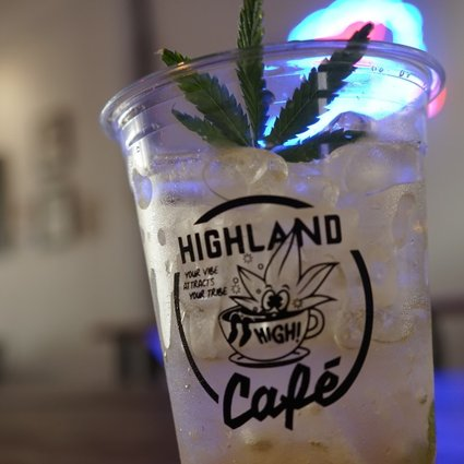 A signature drink garnished with an artificial weed leaf from Highland Café. Photo: Vijitra Duangdee