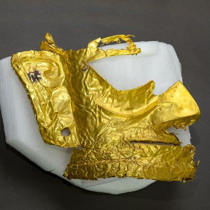 A gold mask that may have been used in religious rituals at the site. Photo: Xinhua