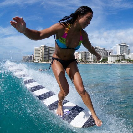 Why Longboard Surfing Is Making A Comeback Especially In Asia And Among Women South China Morning Post Fit surfer woman runs into the ocean with surfboard. why longboard surfing is making a